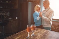 Nice and warm picture of old ouple dancing together in the kitch stock image
