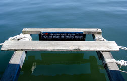 Nice warning on a deck in Victoria bay Stock Images