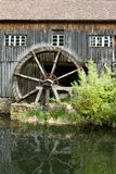 Half Water mill  house in a village in Alsace. Nice Water mill house in a village in Alsace in the summer Stock Photography