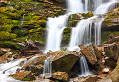 Nice waterfall in Carpathian mountains Stock Photos