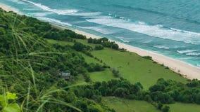 Nice waves on Nunggalan Beach Coastline, Uluwatu, Bali, Indonesia. Nice waves on Nunggalan Beach Coastline, Uluwatu, Bali - Indonesia. Incognizable couple is stock video footage