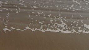 Nice waves on sandy beach,white surge. stock video
