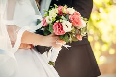 Nice wedding bouquet in bride`s hand royalty free stock photo