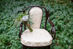 Nice wedding bouquet on vintage chair Stock Photos
