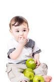 Nice weinig kind met appelen Royalty-vrije Stock Foto's