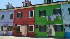 Nice well-kept colorful residence houses, vivid architecture of Burano island. Stock footage stock video