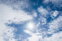 Nice white cloud and sun with fair on the sky Royalty Free Stock Images
