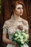 Nice white wedding bouquet in bride`s hand. Bride holding big wedding bouquet on wedding ceremony Royalty Free Stock Photography