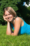 The nice woman. The young woman lies on a grass Royalty Free Stock Image