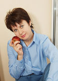 Nice woman with the apple Royalty Free Stock Images