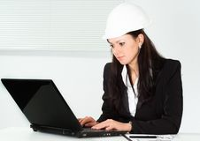 Nice woman in a business suit working Royalty Free Stock Images
