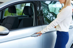Nice woman choosing a car in auto show Royalty Free Stock Photo