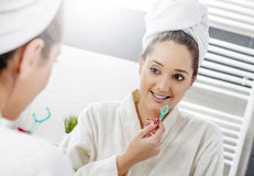 Nice woman cleaning her teeth Stock Photos