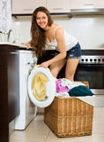 Nice woman with clothes near washing machine Stock Photo
