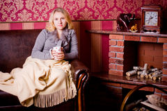 Nice woman with cup of hot tea Stock Photo