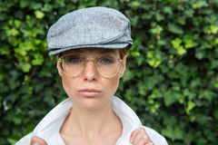 Nice woman dresses up as a man in the twenties years style.  Royalty Free Stock Photo
