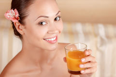 Nice woman drinking juice Royalty Free Stock Image