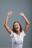 Nice woman exulting and laughing rising arms up Royalty Free Stock Photos