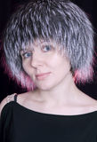 Nice woman in a fur  cap Stock Photography