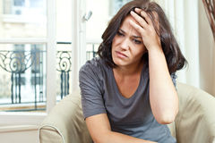 Nice woman and headache Stock Images