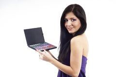 A nice woman holding an eyeshadow set. Studio shot Stock Image