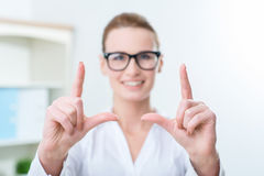Nice woman holding hands in front of her Stock Image