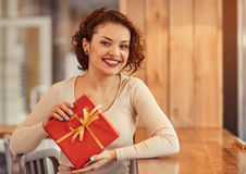 Nice woman holding present Royalty Free Stock Photos
