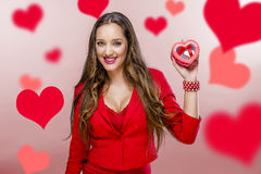 Nice woman holding red heart Royalty Free Stock Photos