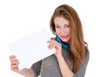 Nice woman holds blank sheet of paper Stock Photography