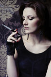 Nice woman model posing as a cigarette smoker Stock Image