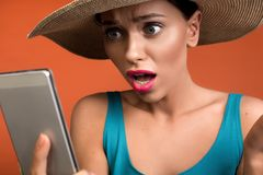 Nice woman receiving shocking news by phone royalty free stock images