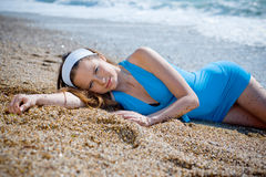 Nice woman relaxing near sea Stock Images