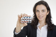 Nice woman showing pills Stock Image