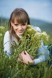 Nice woman with spring flowers Stock Images