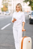 Nice woman standing near road Royalty Free Stock Photos