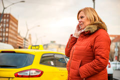 Nice woman on the street with a phone Royalty Free Stock Photography