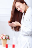 Nice woman taking care of her hair Royalty Free Stock Photo