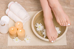 Nice woman taking care of her legs Royalty Free Stock Image