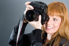 Nice woman taking pictures Stock Images