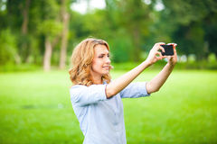 Nice woman taking pictures with smartphone Royalty Free Stock Photography