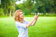 Nice woman taking pictures with smartphone Royalty Free Stock Photos