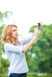 Nice woman taking pictures with smartphone Stock Photos