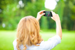 Nice woman taking pictures with smartphone Stock Images
