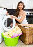 Nice woman washing clothes in washer Royalty Free Stock Photos