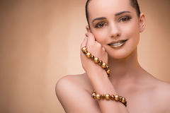 The nice woman wearing elegant jewellery Royalty Free Stock Image