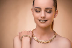 The nice woman wearing elegant jewellery Royalty Free Stock Photography