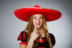 The nice woman wearing red sombrero hat Royalty Free Stock Image