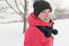 Nice woman in winter outdoors having fun stock photo