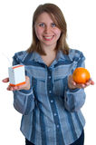 Nice women with juice and orange on hands Royalty Free Stock Image