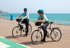 Nice - Women police officers. NICE, FRANCE - MAY 2: Women police officers on bicycles. Côte d'Azur, the Promenade des Anglais on May 2, 2013 in Nice, France Royalty Free Stock Image